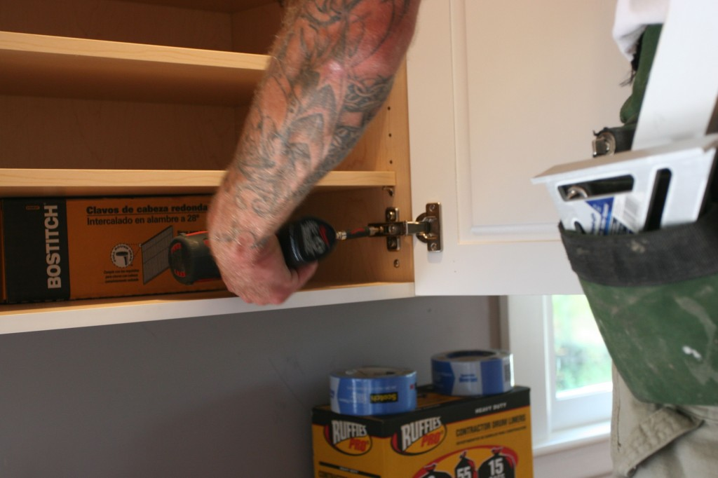 There are two screws on each hinge that adjust forward/backward and right/left. The hardware is easily the best part of the cabinetry.