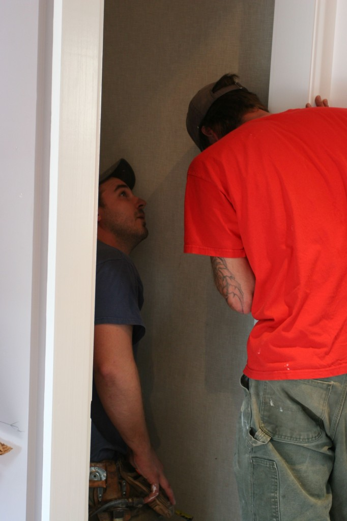 "Dave and Eric assessing the amount of ""meat"" behind the door jamb for the hinge screws to hang from."