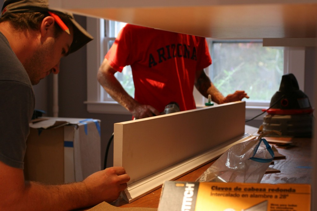 Working the last head casing for over the refrigerator.