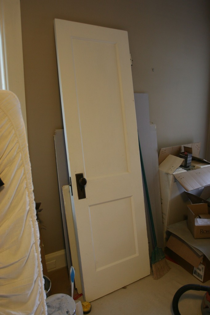 This is the door we removed from the bathroom. I think we'll save it for a future closet renovation (if we get to it).