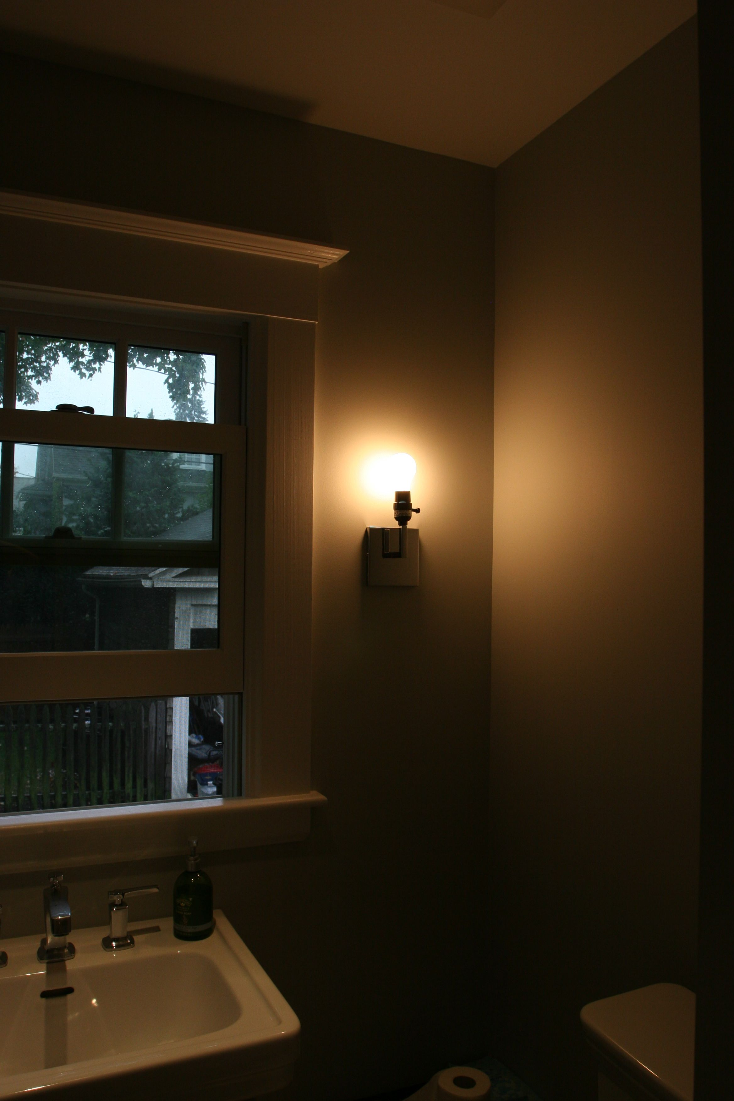 Powder room sconce! The shade is still all wrapped up for protection.