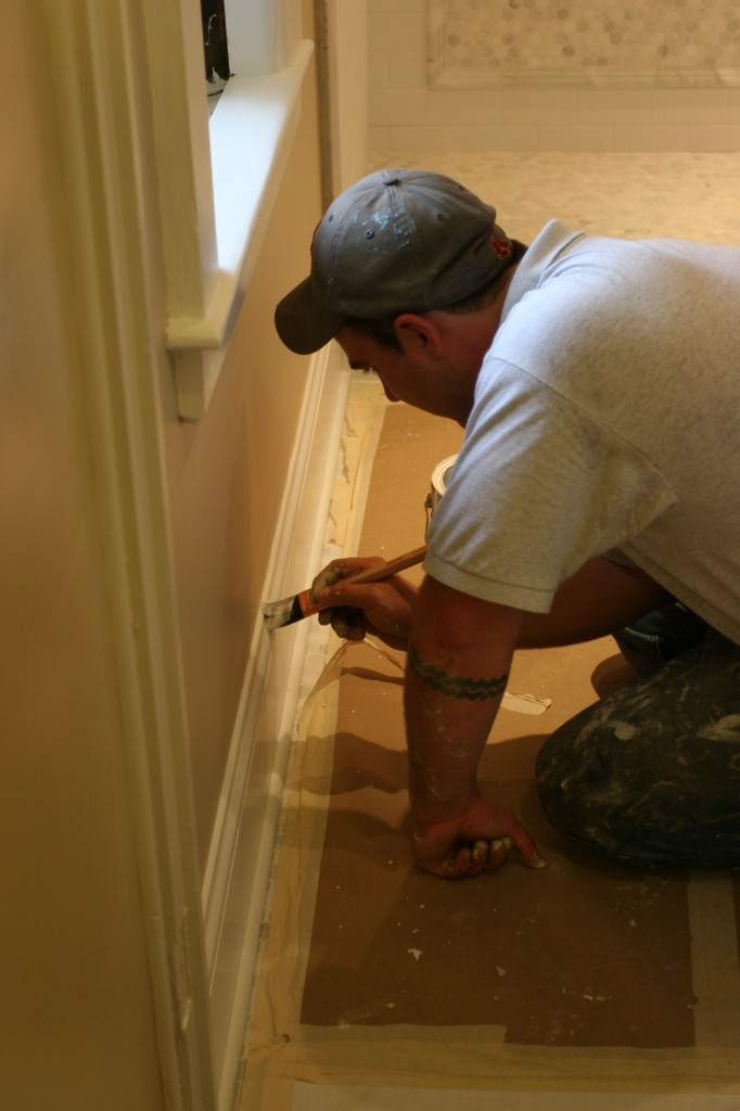 Dave painstakingly straightening out a cut line on the baseboard. This is why we love him so.