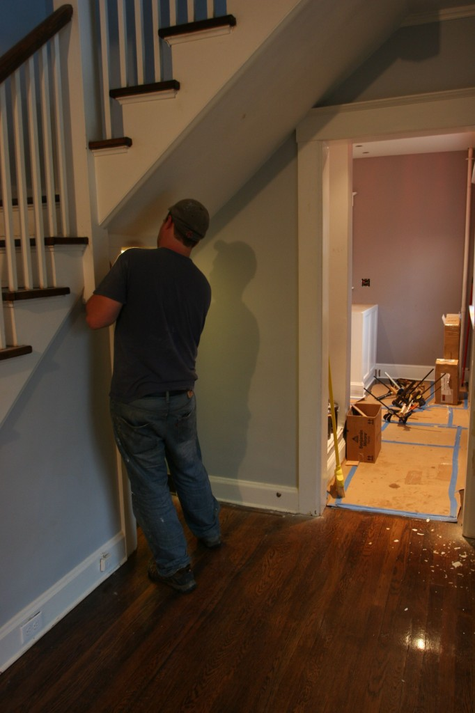 Dave sanding away at the trim. I dug his shadow on the wall.