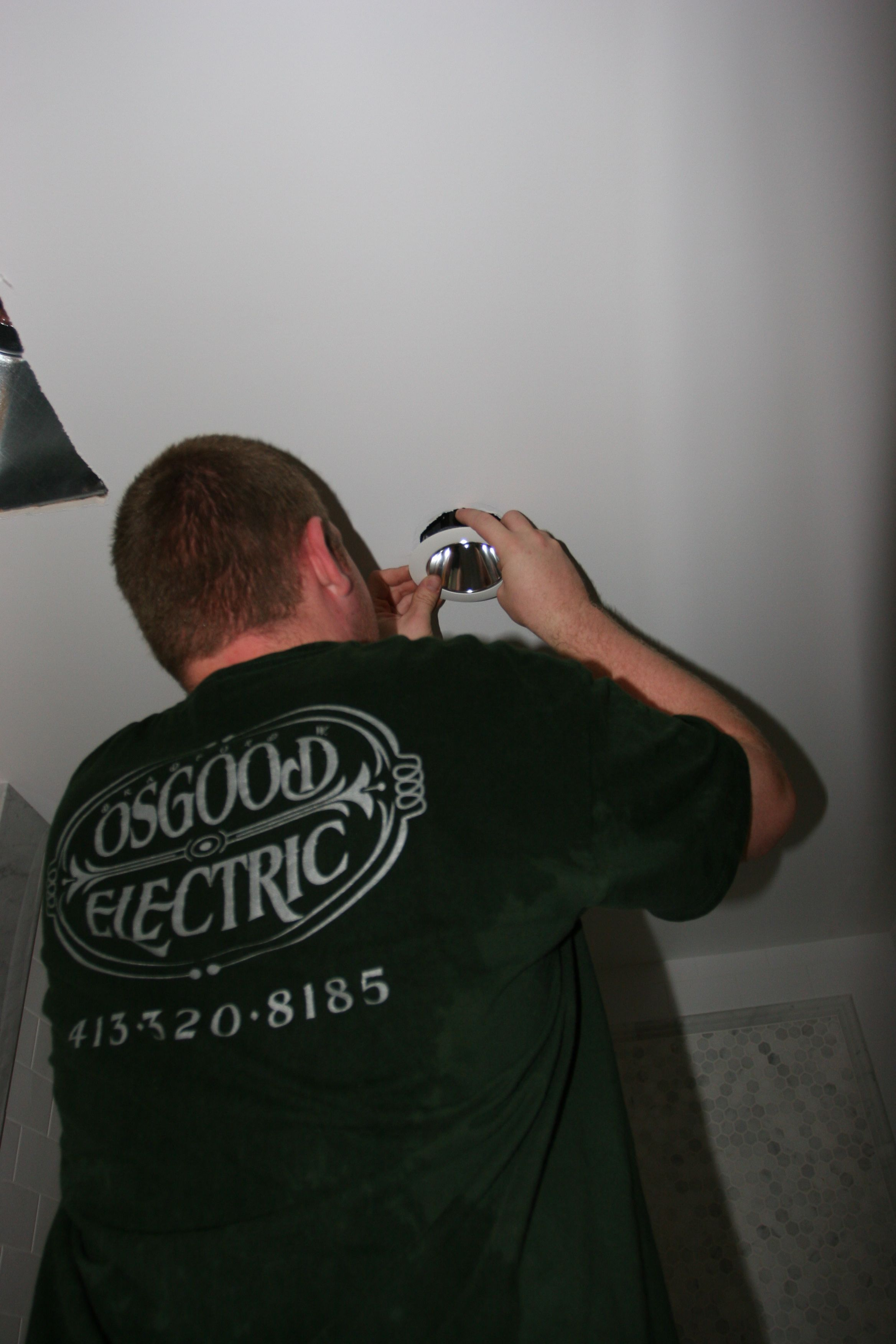 Brad trimming out the master shower light.