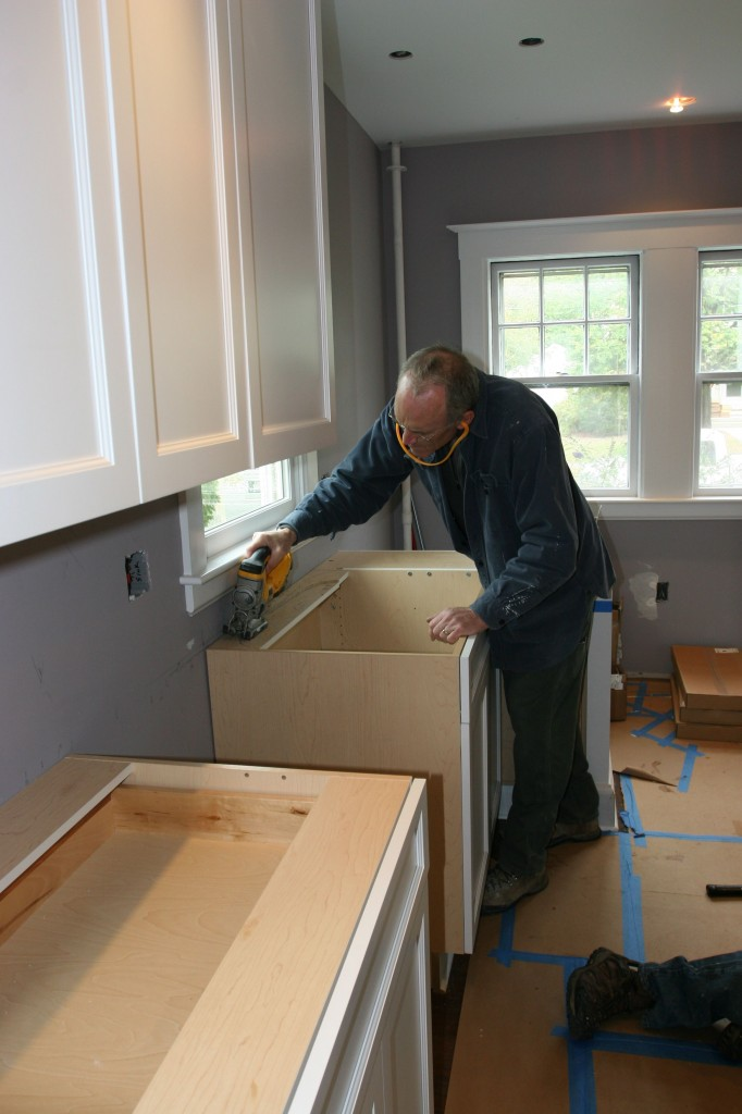 Tom cutting out the part of the cabinet that will interfere with the sink basin.