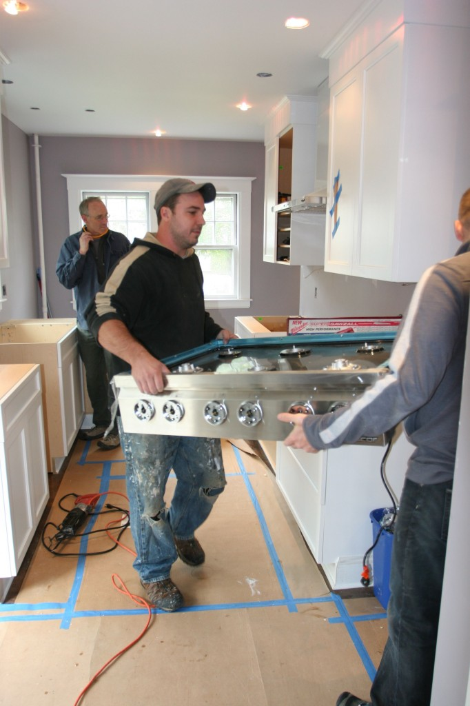 Jeff and Dave moving the appliances out of the way so they won't get damaged (or be in the way for the install).
