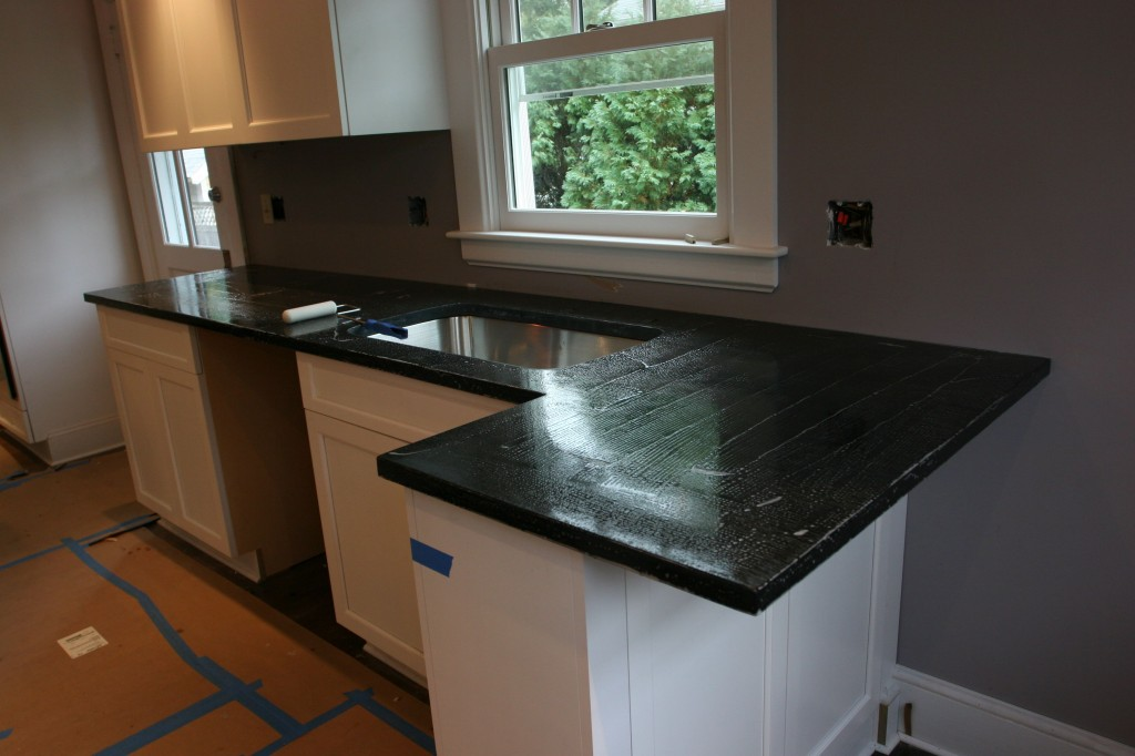The lovely countertops, mid-sealer coat.
