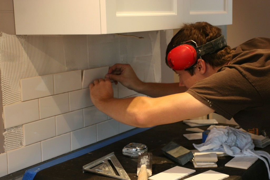 J.J. working hard making that backsplash gorgeous.