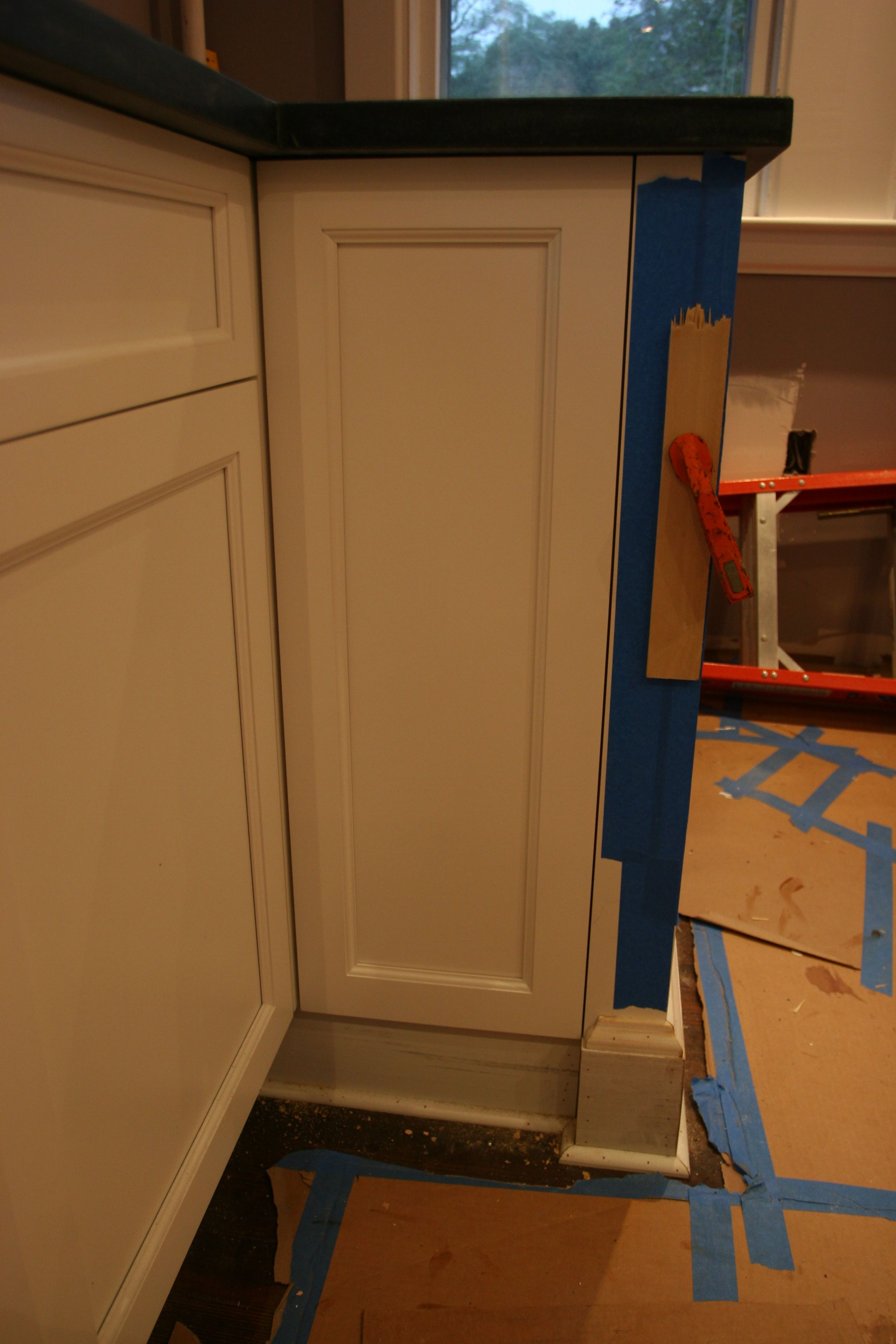 The door panel, cleverly adhered with some silicone and some back-screwing.