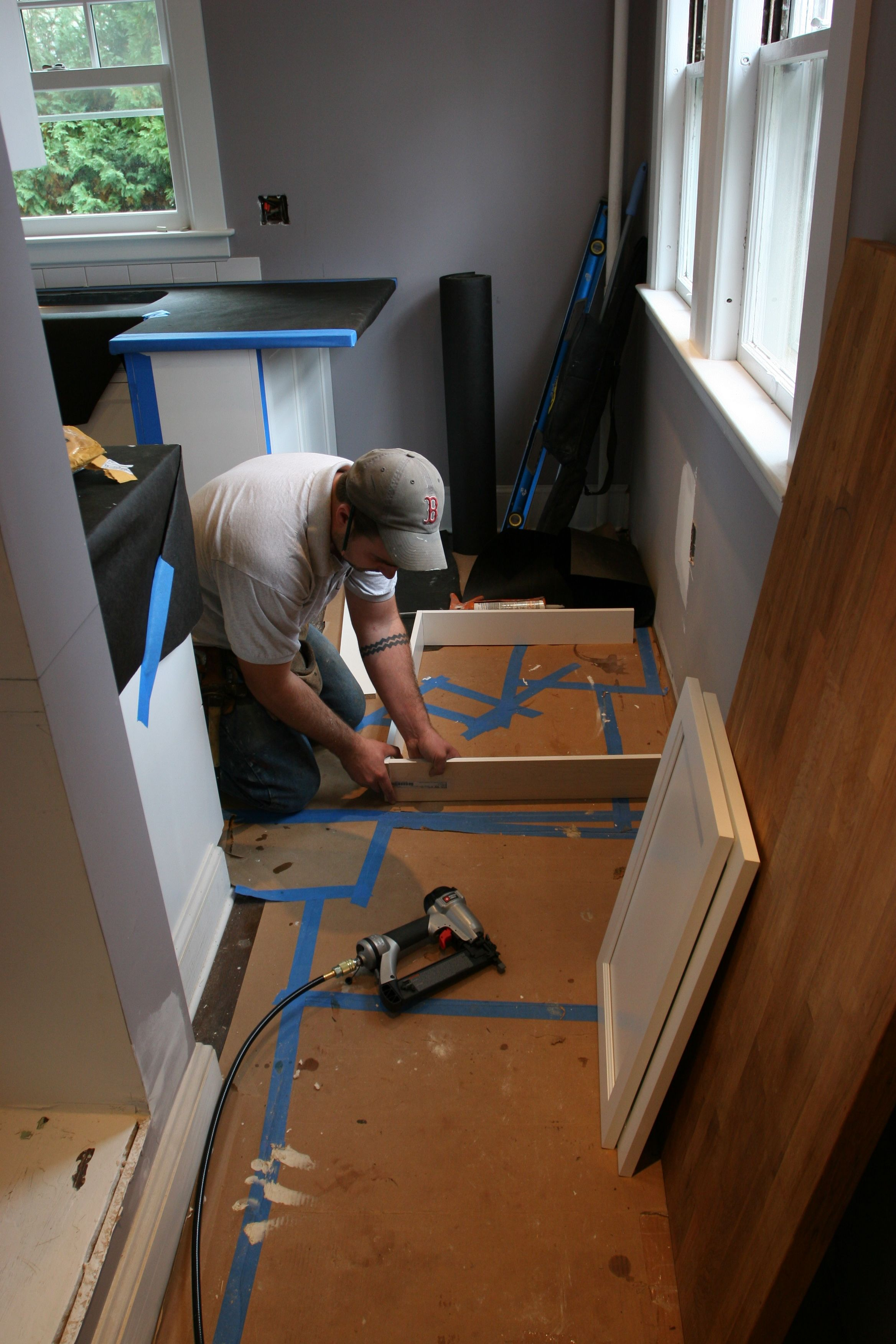 Dave using up some toe-kick material to make a box to hinge the doors onto for the pantry cabinet.