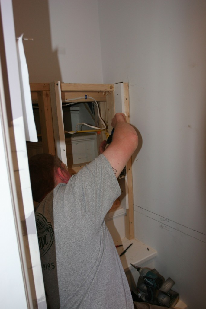 Brad inching the outlets and wires forward to the correct position.