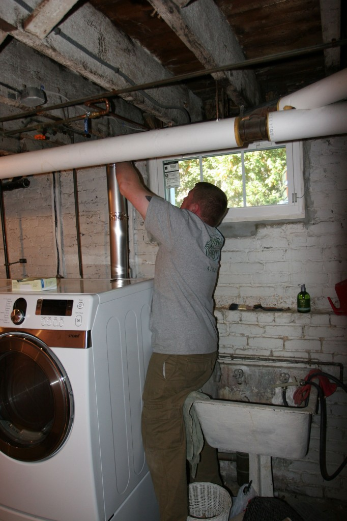 Brad fixing up our dryer vent. We have clean clothes again!