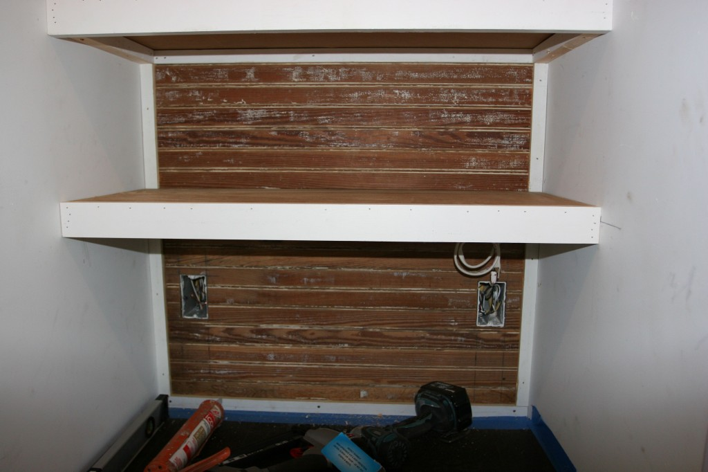 Reclaimed beadboard, cute little shelf. I'm smitten.