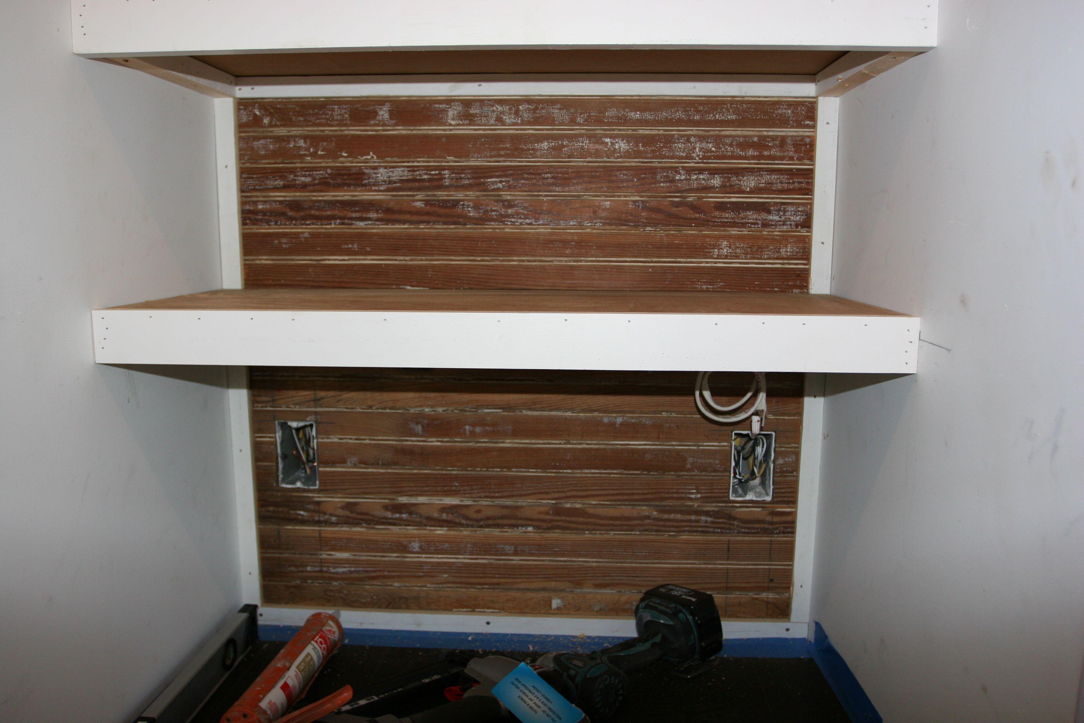 Reclaimed beadboard, cute little shelf. I'm smitten.