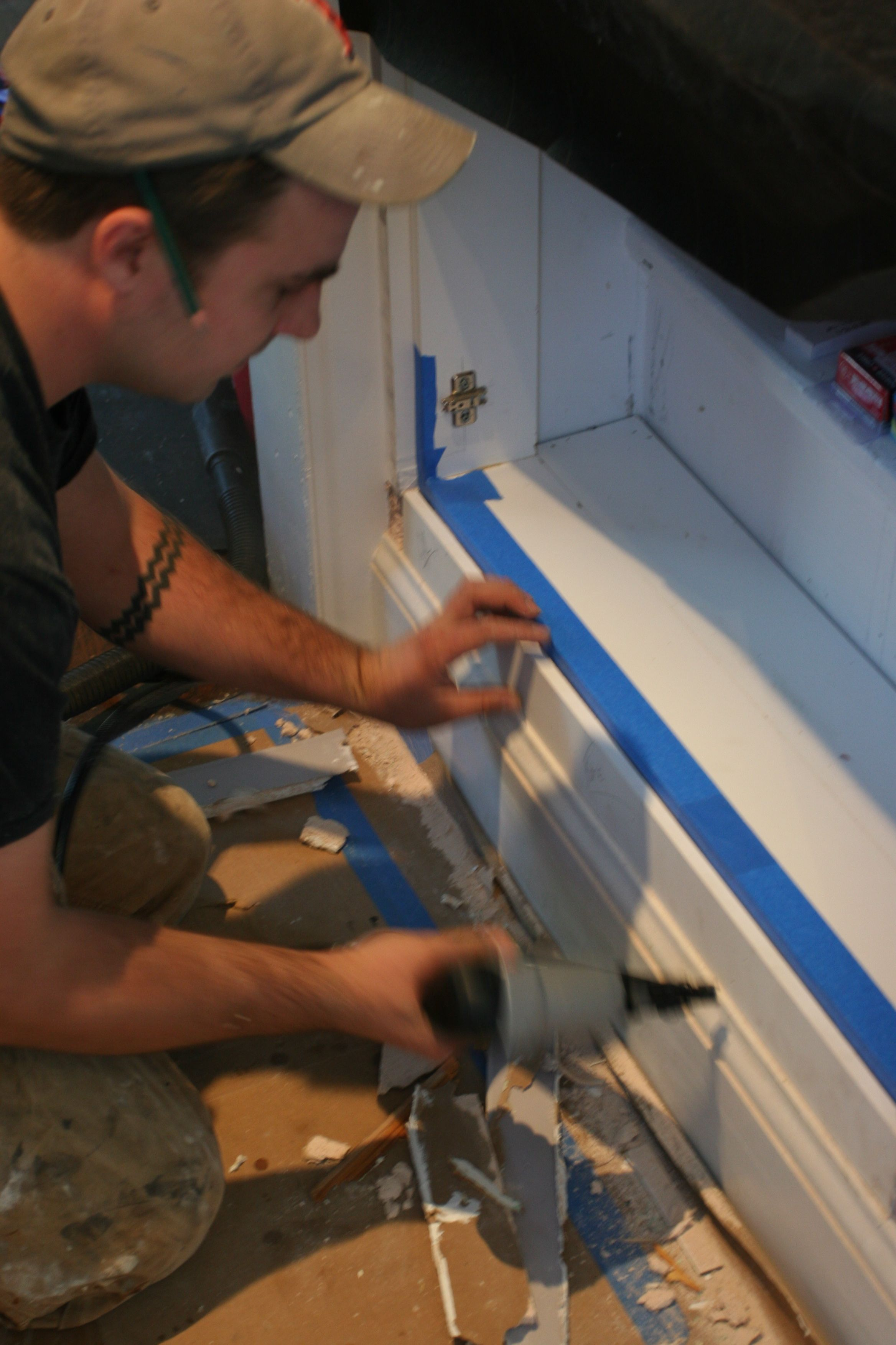 Dave adding a bit of smooth surface to make the pantry look more built-in.