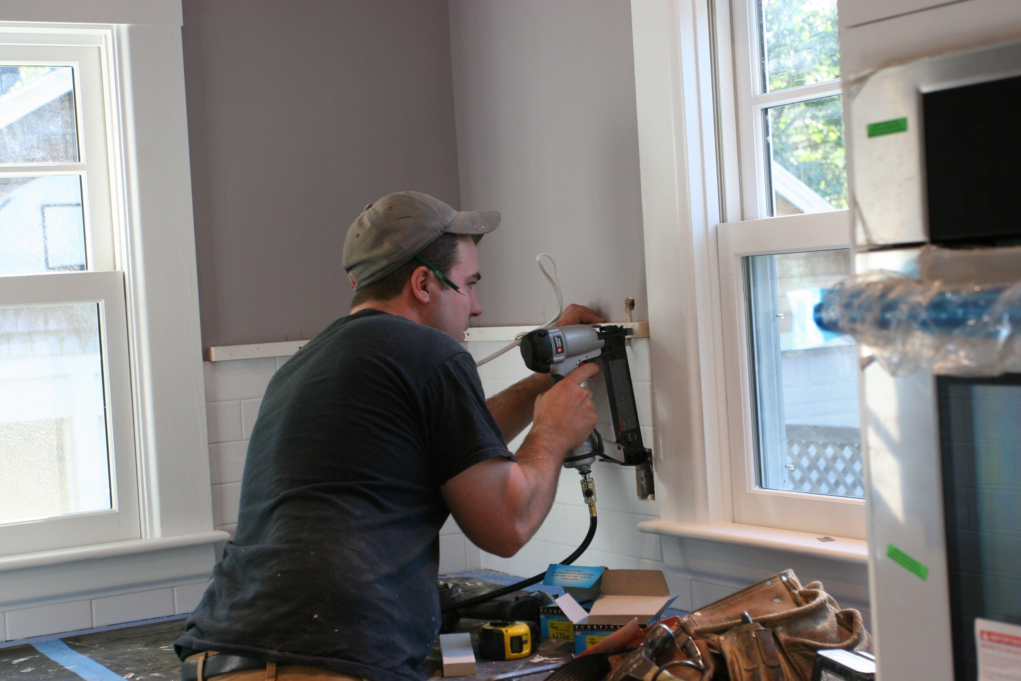 Dave installing a ledger board.