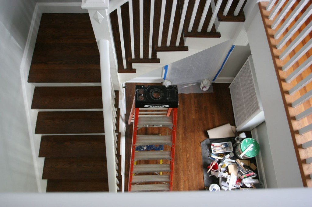 I spent most of Thursday painting the staircase: the newel posts, hand railings, risers and baseboard trim along the wall, as well as the little door underneath the stairs.