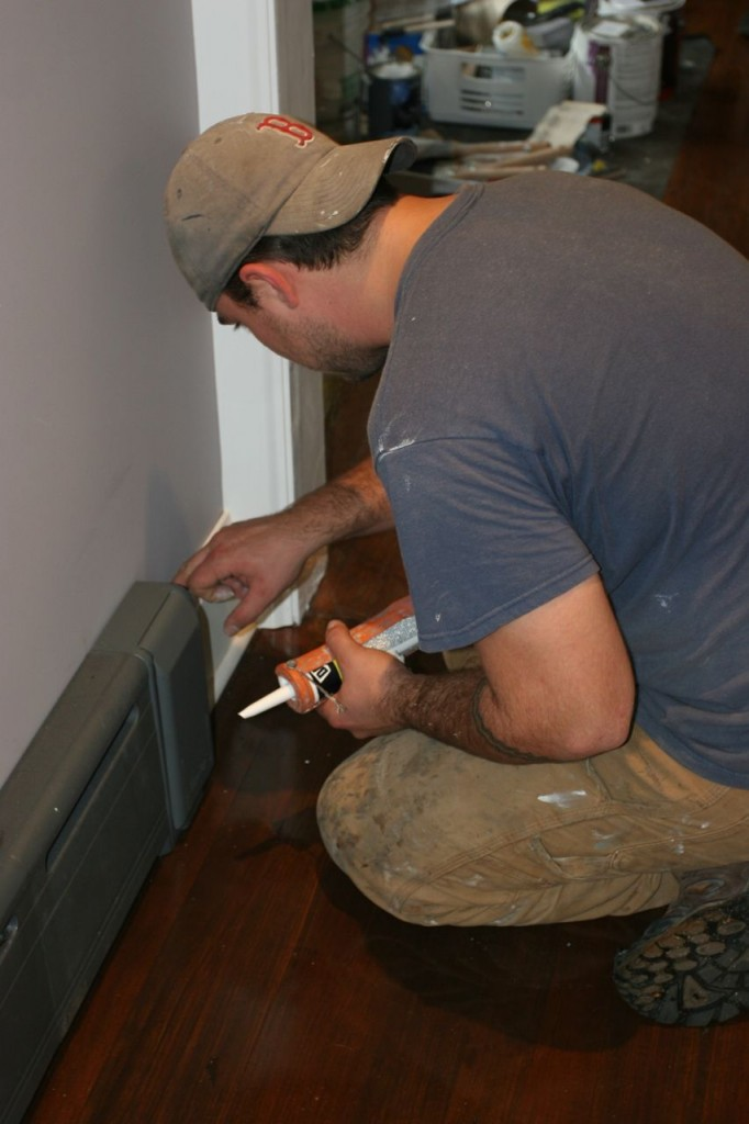 Dave finishing up the baseboard trim.
