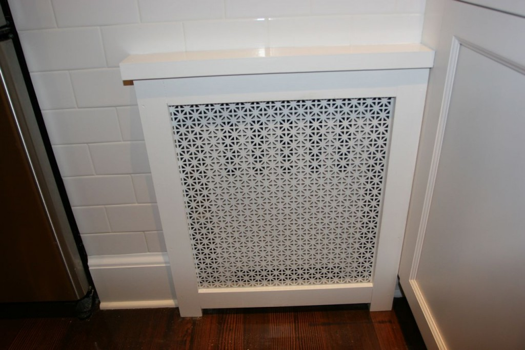 Tile: fixed! Radiator cover: adorable! I'm telling you, this is the stuff that makes the room come alive. L.O.V.E.