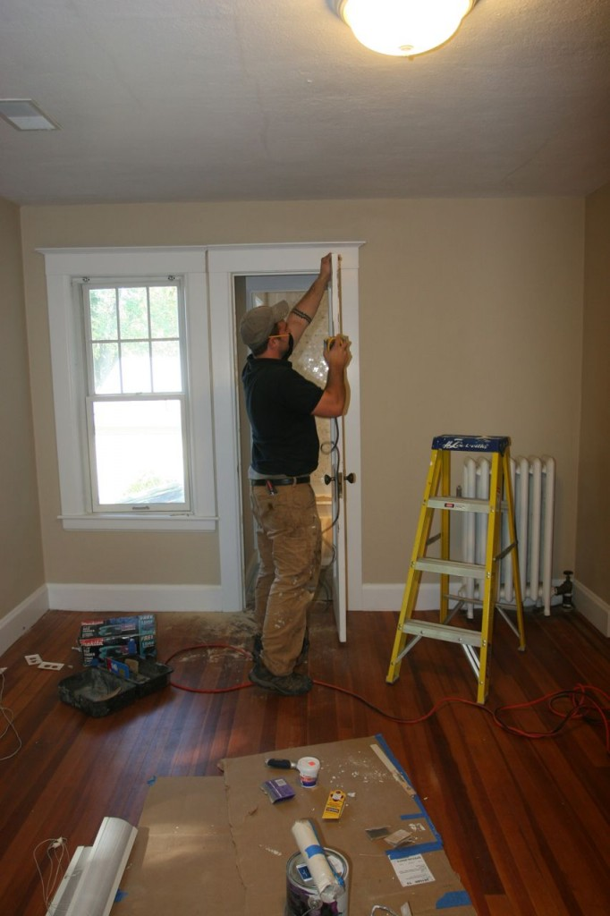 Ok, here's the first of my shots (obviously). Dave prepping our door that didn't close (we never tried to close it for privacy before).