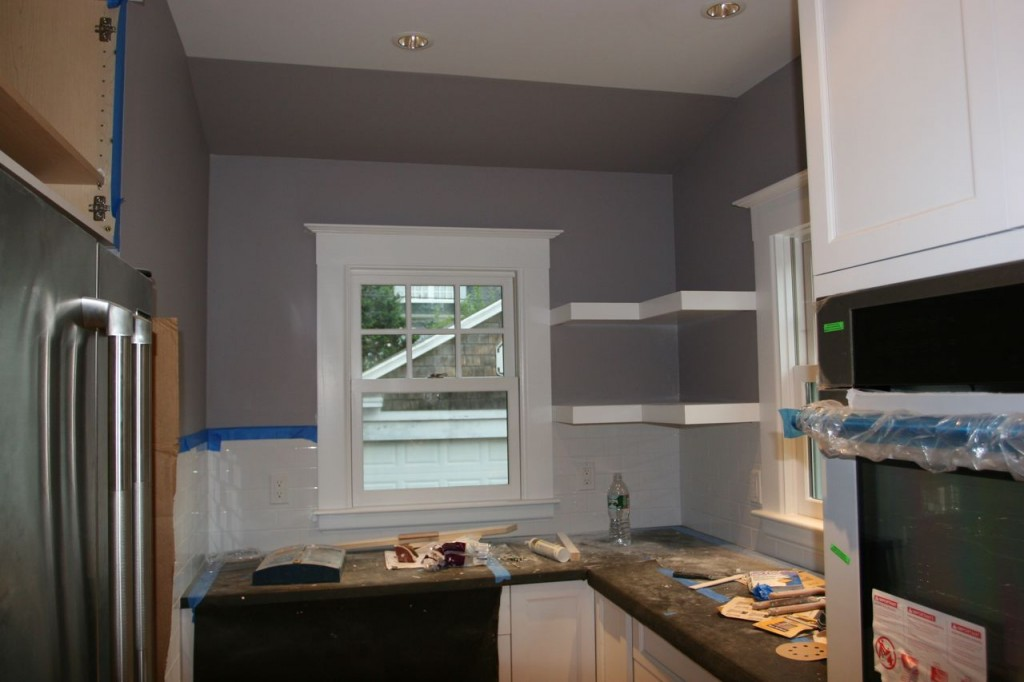 Wall: painted. Window trim: painted. Shelves: painted. Tile: sealed. Countertops: installed. So, so close.