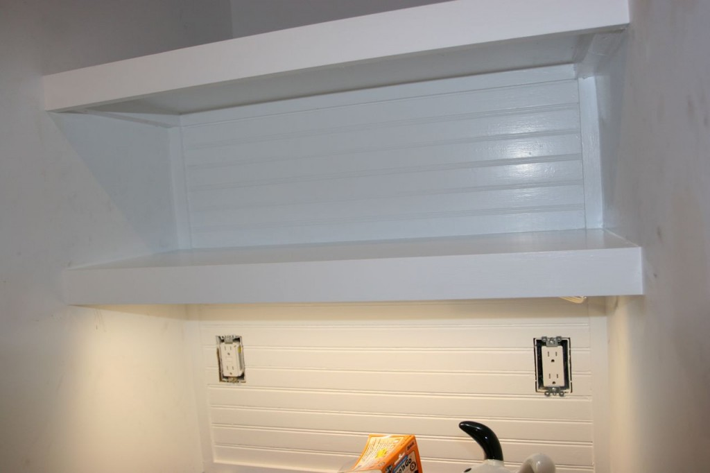 Beadboard: coated with more paint. Undercabinet lights: installed. Outlets: installed. Tea and toast: yes, please!