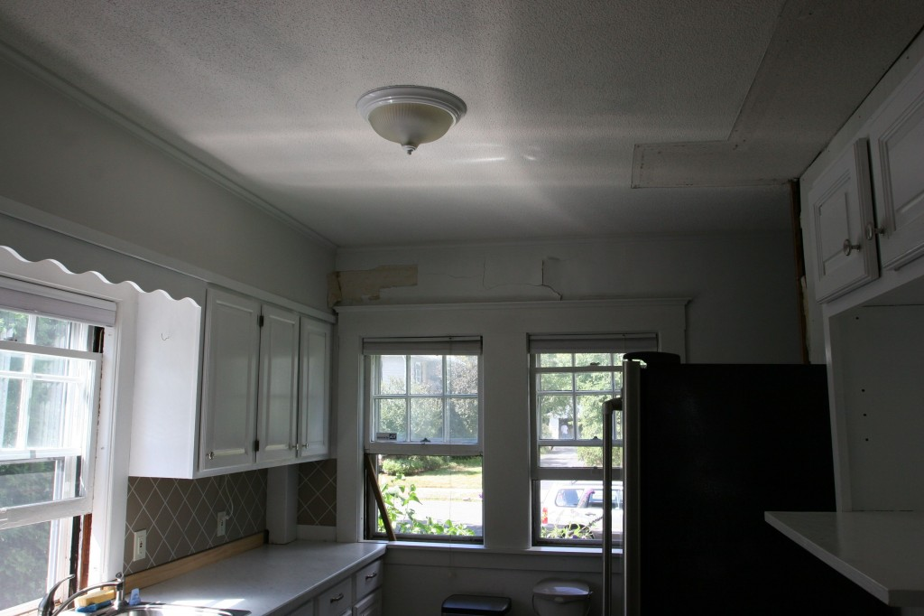 When you looked to the front of the kitchen, the windows were partially obscured by the side of the fridge.