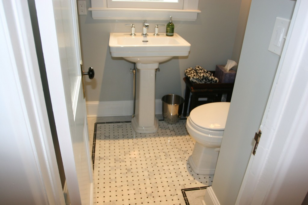Toto Promenade toilet and sink; Kohler Margeaux faucet. Marble tile basketweave with marble surround. Floor heat by NuHeat.