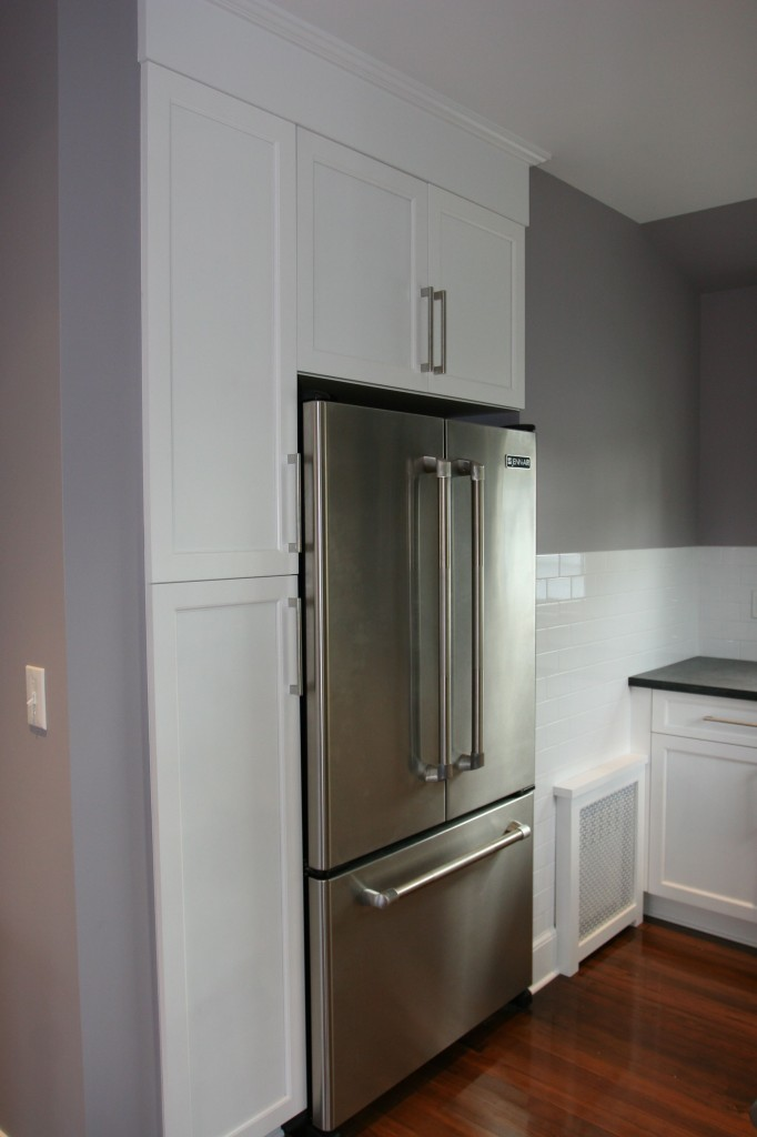 Our cute little fake built-in fridge. Jenn-Air refrigerator, cabinets by Ultracraft.
