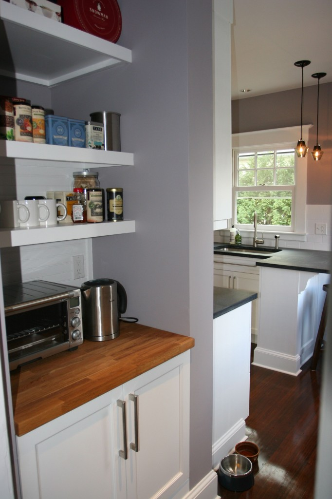 The tea n' toast pantry looks like it's always been there, alongside the stunning kitchen.