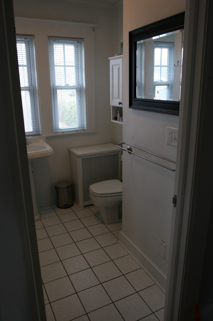 Behind that mirror is an adjacent bedroom's closet, so there's no hope of enlarging the space.