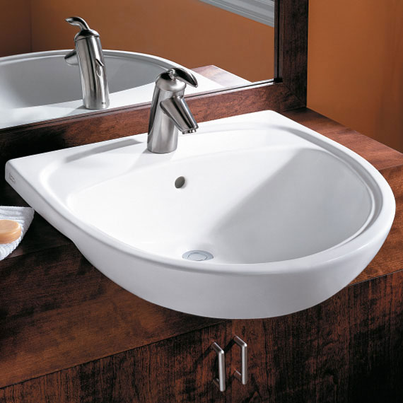 This is an image of the sink we ended up getting. The sink will install proud of the countertop, with a bowl-like look to the front. Not really in keeping with the period aesthetic, but function (and price) beat out form in this case. I think it'll still work. You'll see, you naysayers out there. You'll see.