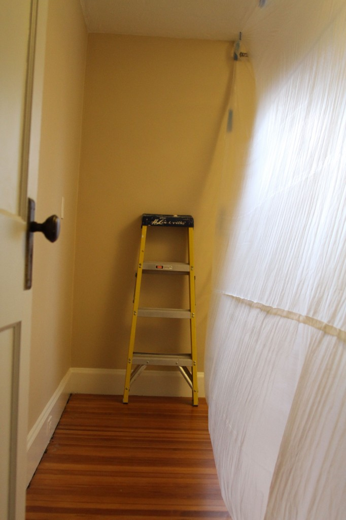 Jeff put up this painter's plastic wall to divide the rest of our bedroom from the work zone. We didn't protect the floors this time, since we knew that we'd need to sleep in this room every night. So I hovered with a broom and vacuum.