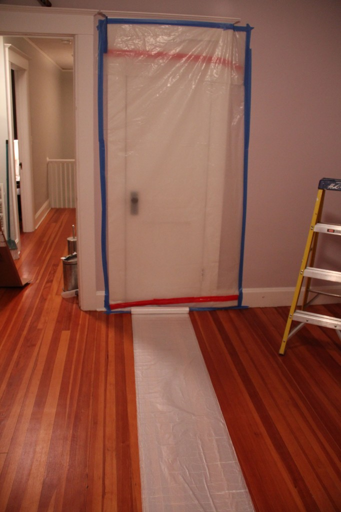 Step one: plastic. Lightweight painters' plastic should cover the floor. The room is small, so the 10' width meant we just had to cut it to length.