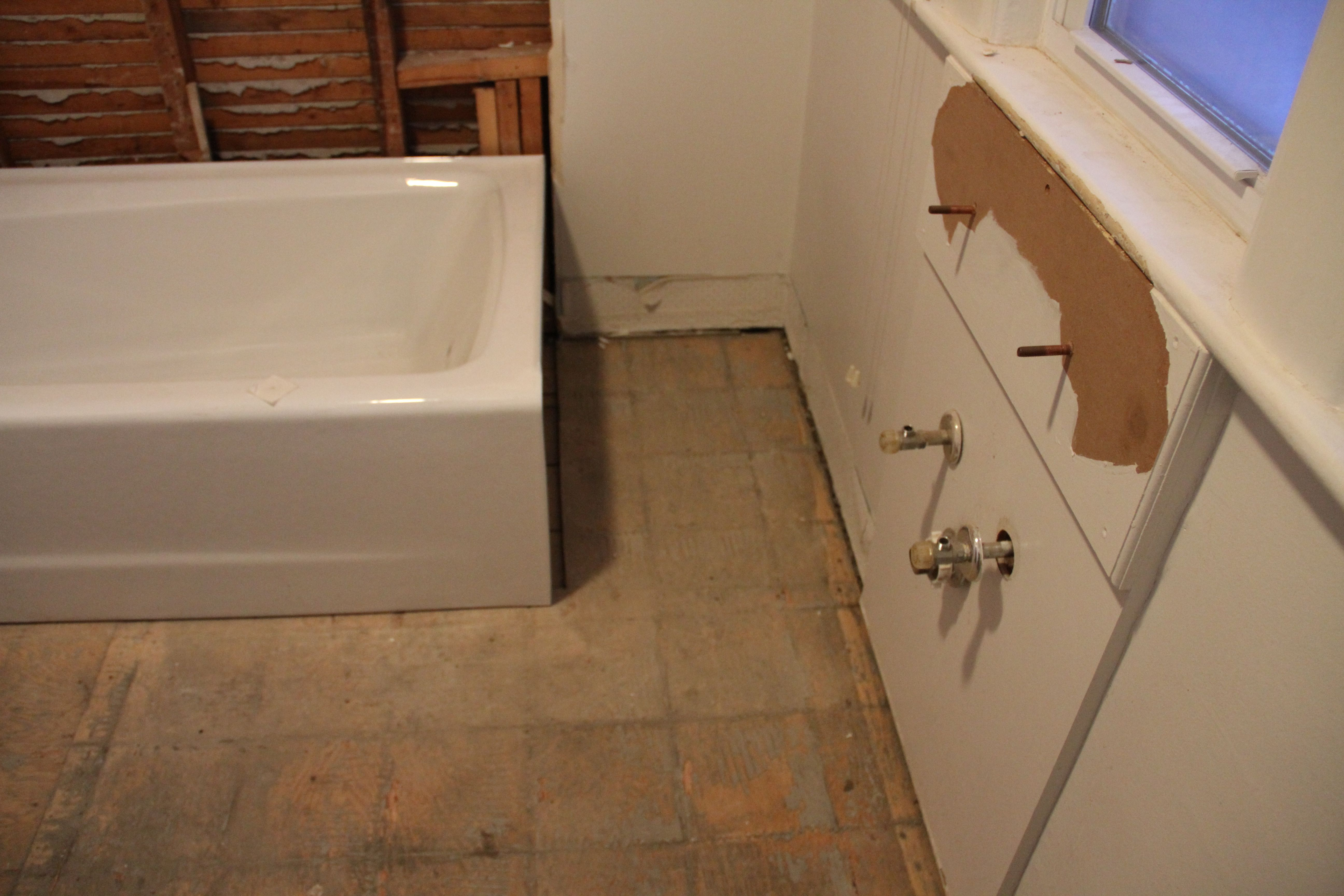 The tub will get closer to the wall when the plumber does his thing. Not much space extra to work with, but I'm (we're) gonna make it better than before.