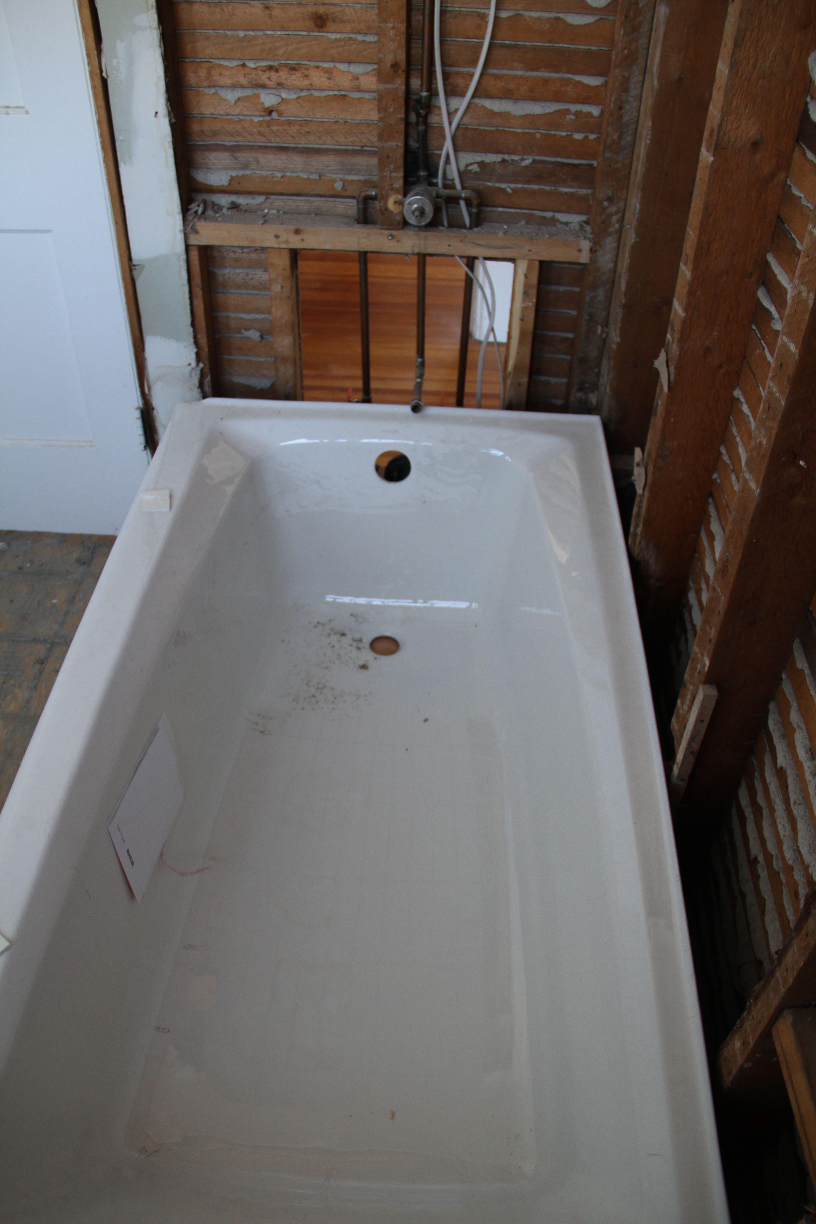 You can see better how the plumbing didn't line up with the new tub. But only barely. Enough to matter.