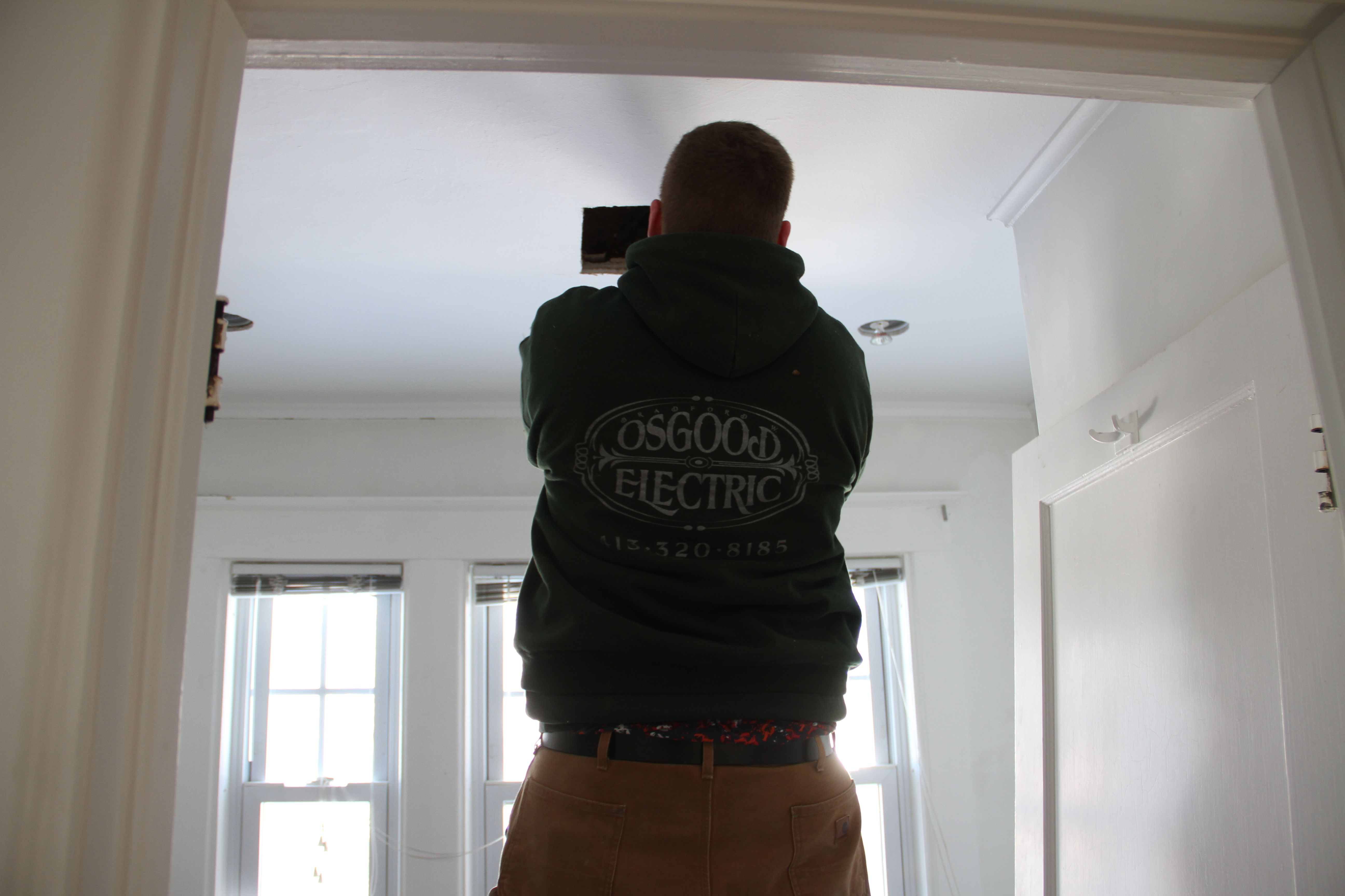 Back to the future, where Brad was installing our uber quiet (whisper quiet) ceiling fan. Love those things.