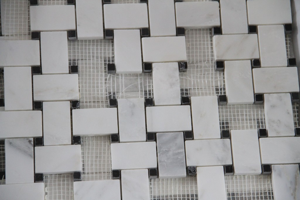 I hand selected tiles from the OTHER mosaic to create little squares. J.J. simply trimmed each one individually.
