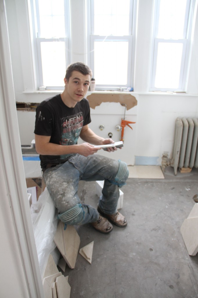 He's always so happy, even when his knees are achey, and he's tired and missing his family. Oh, and he was honing each cut side of the tiles to mimic the factory edge so the grout lines would be uniform.