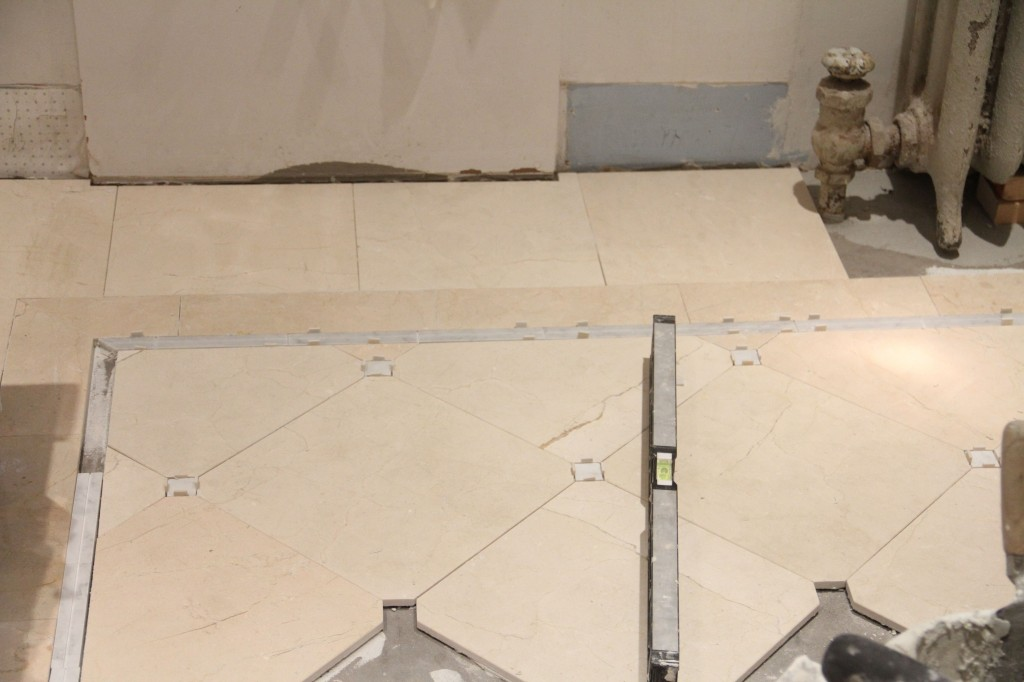 Each area was checked for level with every surrounding piece of tile. That floor is flat, baby!