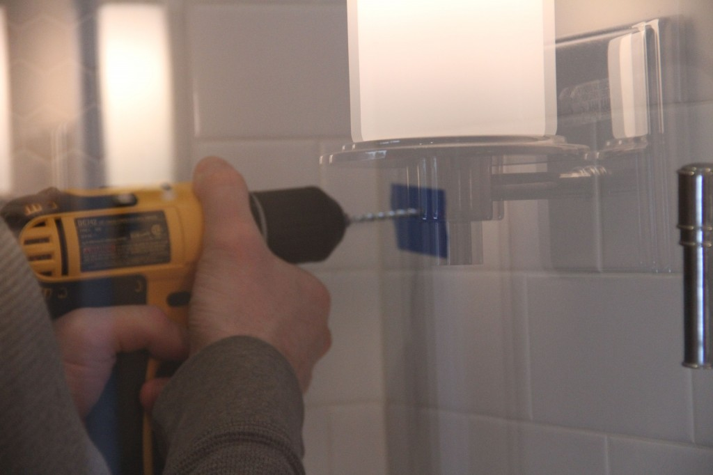Jeff took the plunge and drilled into our shower wall. I was nervous, but tried not to let it show.