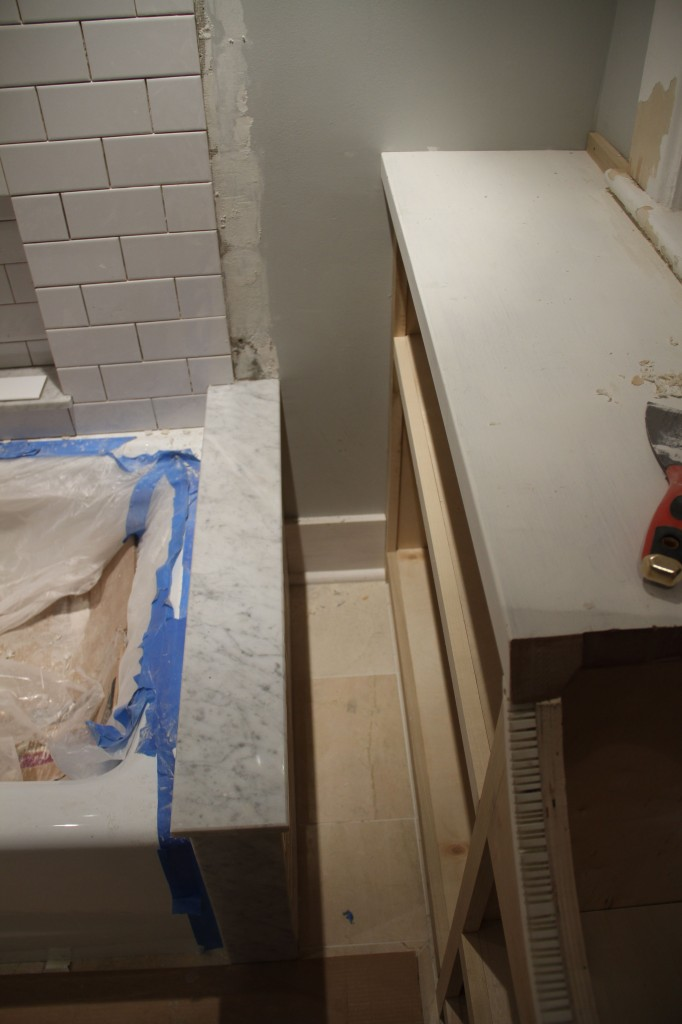 Even that little bit of wall needed baseboard. The shower curtain will fit nicely in that little slot.