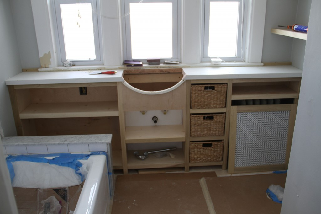 Here is the cabinet, sans sink, but with the baskets we bought for the cubbies.