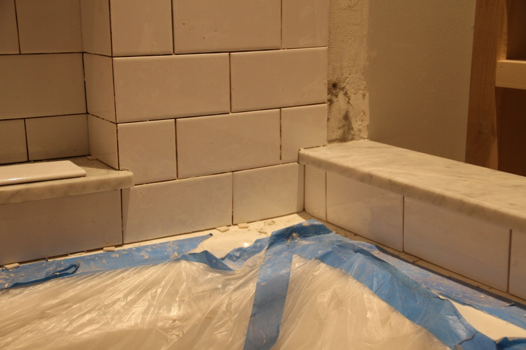 The white area to the right of the horizontal tile will be bordered with partial tiles going vertically. Last little step.