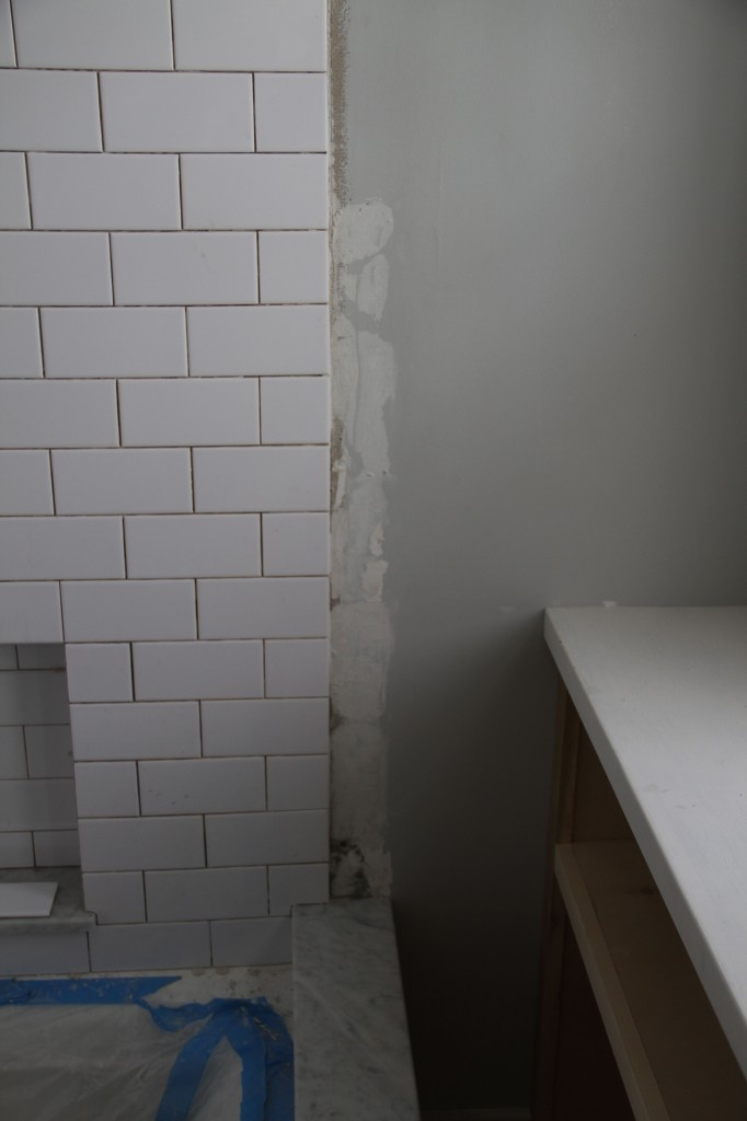 That little area is the only thing that's standing in the way of calling the tile work done in here. So, so close!