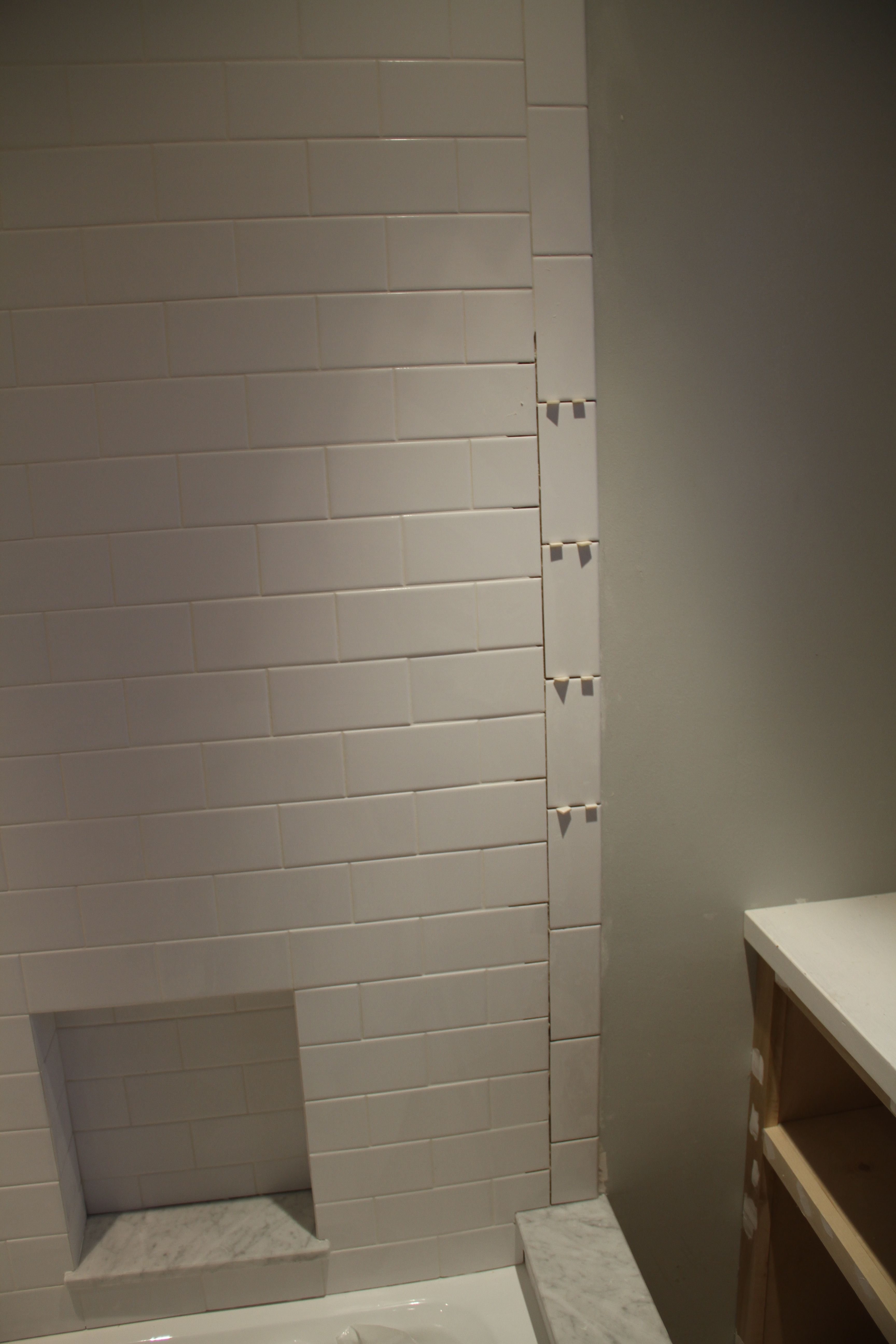 Isn't it amazing how different it looks with grout? And this was before it was totally finished.