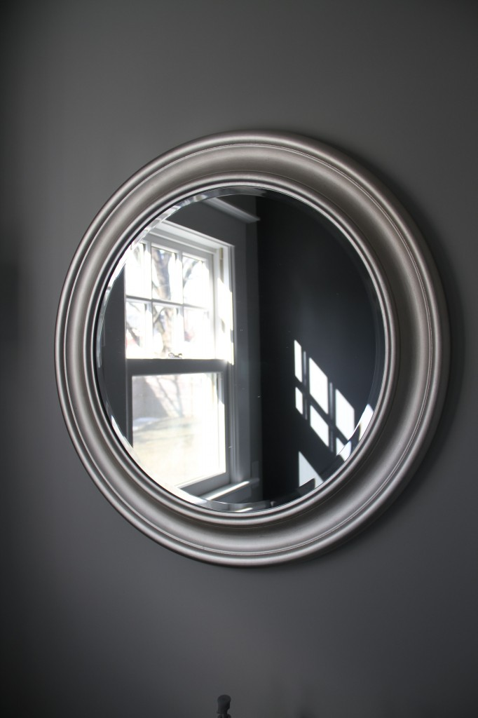 Before: reflection of the accent wall through the mirror (IKEA). Wall color: Cliffside Grey in Benjamin Moore Aura Bath & Spa.