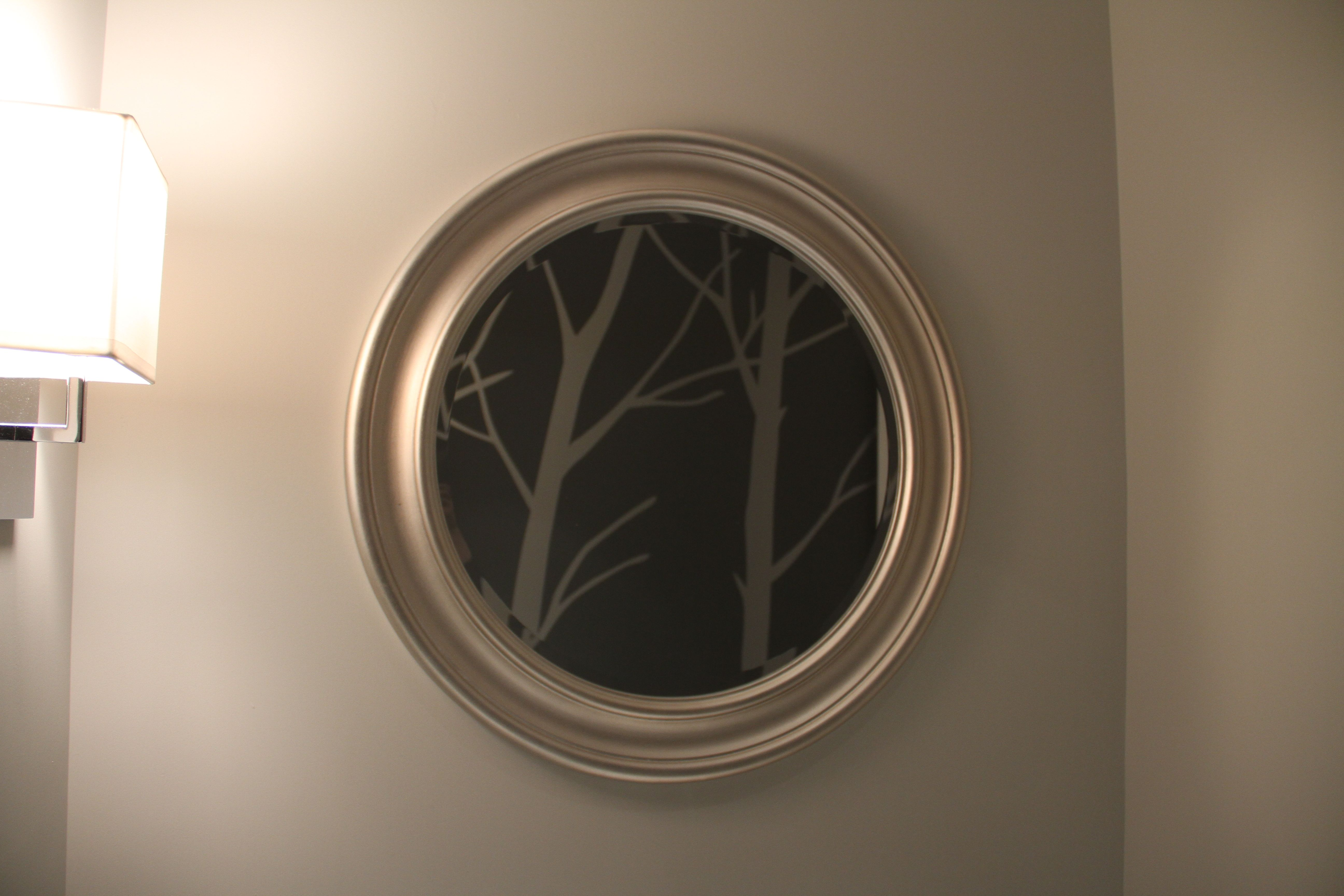 I like how the mirror turns into a little piece of art. And if you're standing there washing your hands, or freshening up, you can see out the window through the mirror, too, to all the giant maple trees in the surrounding yards.