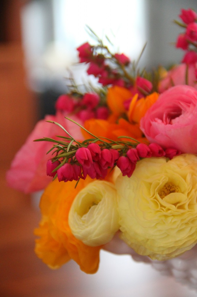 Ranunculus in yellow, orange and pink, with some other flower I can't recall adding a shot of hot pink. Edible, no?
