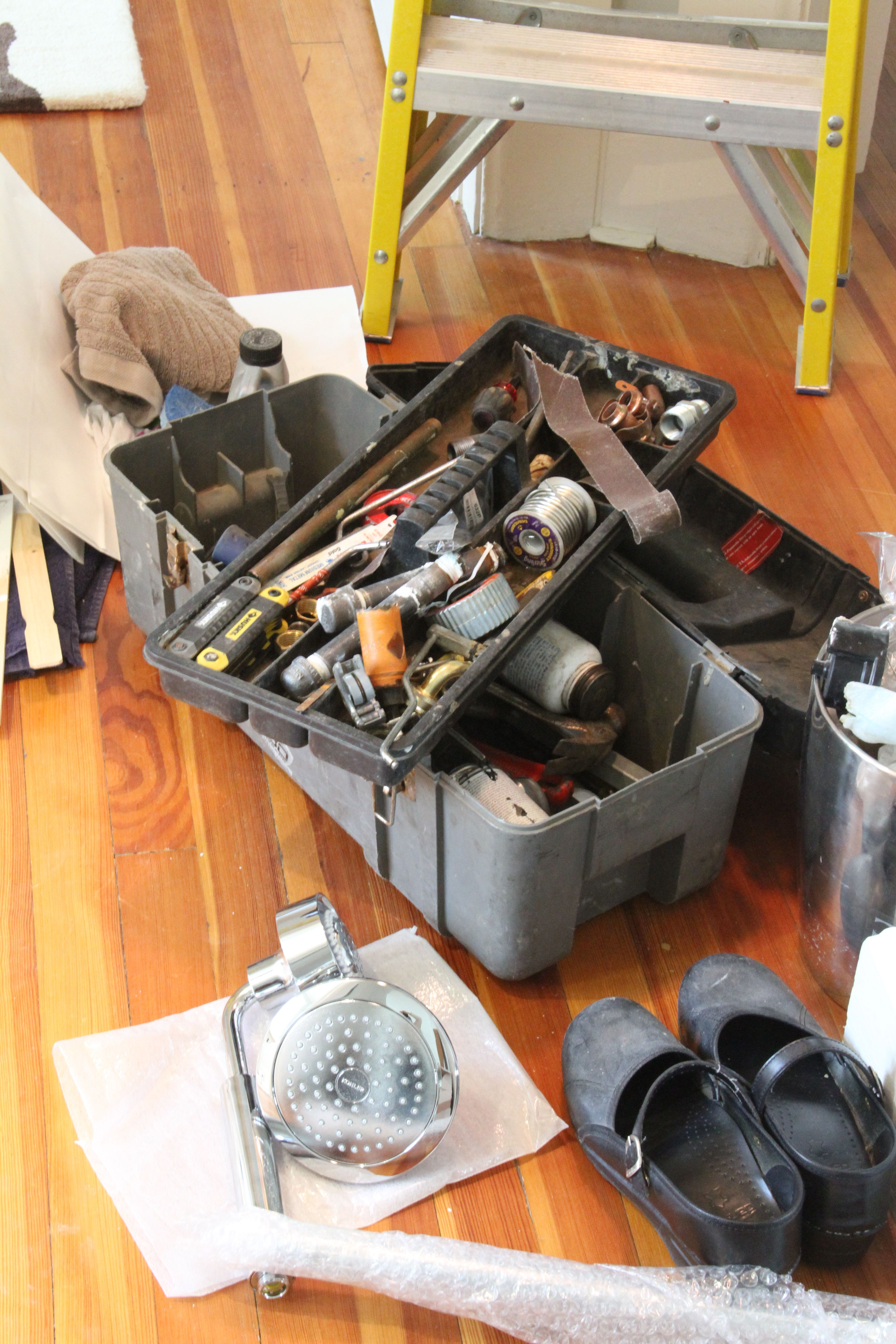 Dave needs a new tool box. And those are my shoes, not his.